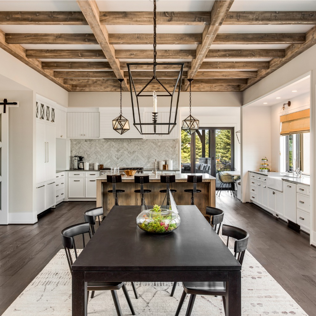 stunning-kitchen-and-dining-room-in-new-luxury-home-wood-beams-and-picture-id950127464.jpg